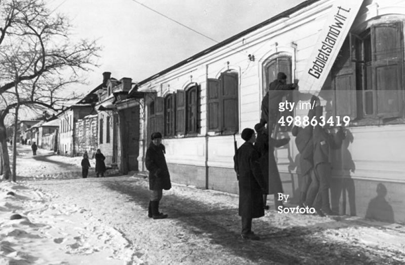 Removing German signs in liberated Belgorod, USSR. February 1943.  Sovfoto