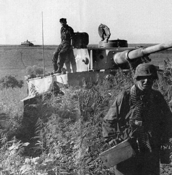 Battle of Kursk - Tiger early production model sits behind an embankment as a cover.jpg