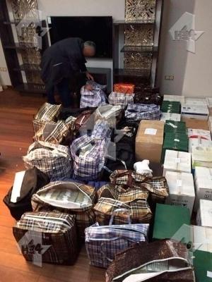 Деньги Захарченко -- в квартире и в суде