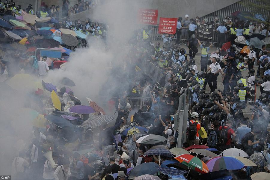 1411910562408_wps_31_Riot_police_use_tear_gas_