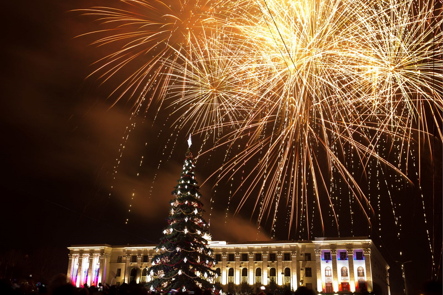 Fireworks go off over central Simferopol, Russia. Сергей Мальгавко ТАСС Getty Images.png