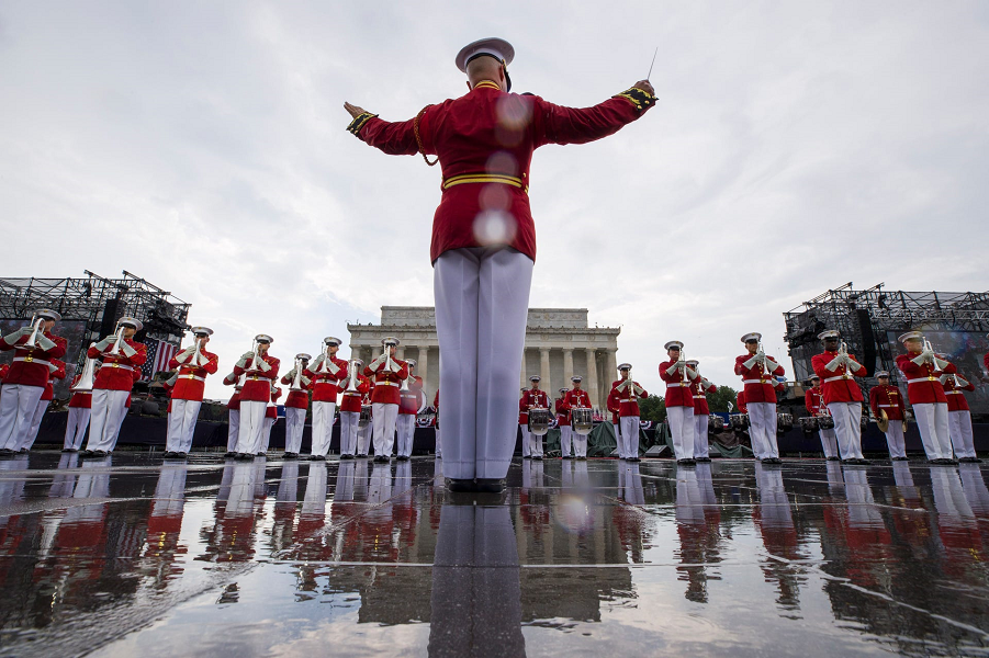 The U.S. Marine Corps Drum and Bugle Corps performs in the rain during an Independence Day, Thursday, July 4, 2019, in Washington. Alex Brandon, AP.…