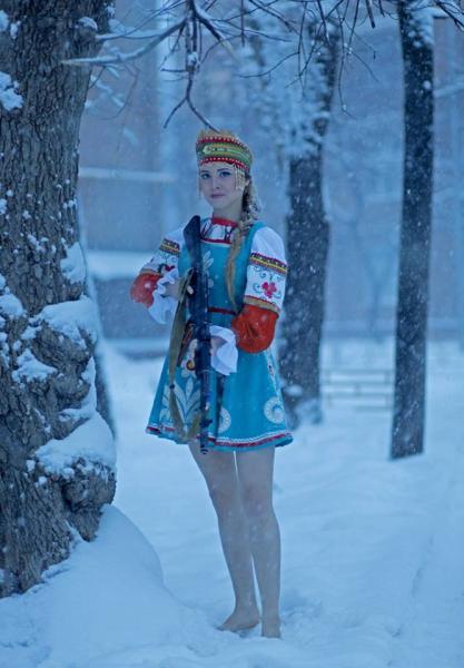 russian folk female with gun in winter