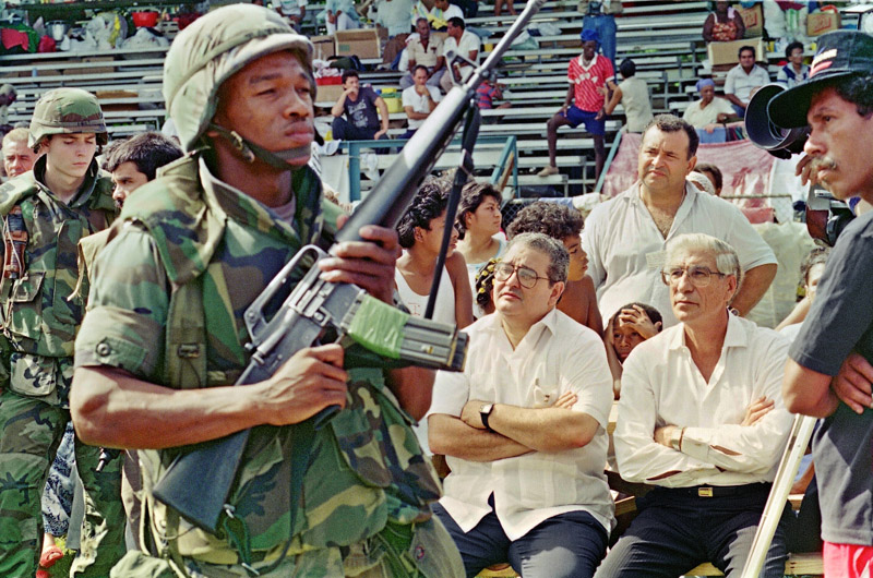 A US soldier guards President Guillermo Endara