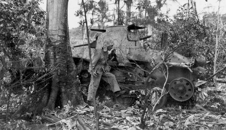 Ha_Go_Light_Tank_blown_off_on_Saipan_1944