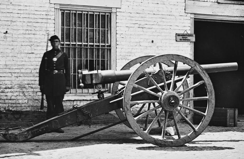 Richmond, VA Federal soldier guarding cannon. (Modified 12-pdr. breech-loading Whitworth)