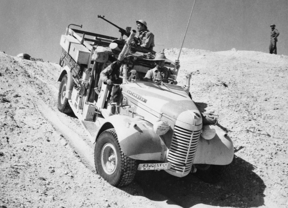 A_Long_Range_Desert_Group_Chevrolet_30cwt_1533_truck_negotiates_the_slope_of_a_sand_dune_during_a_patrol_in_the_desert_27_March_1941._E2298.jpg