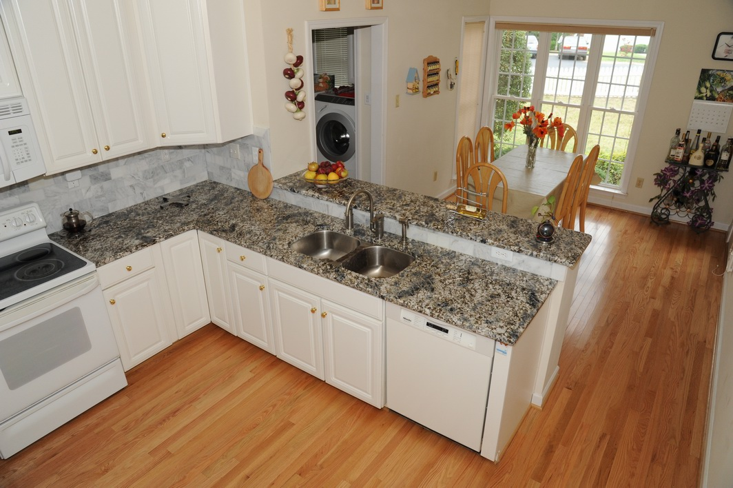White Kitchen With Azul Aran Granite Countertops