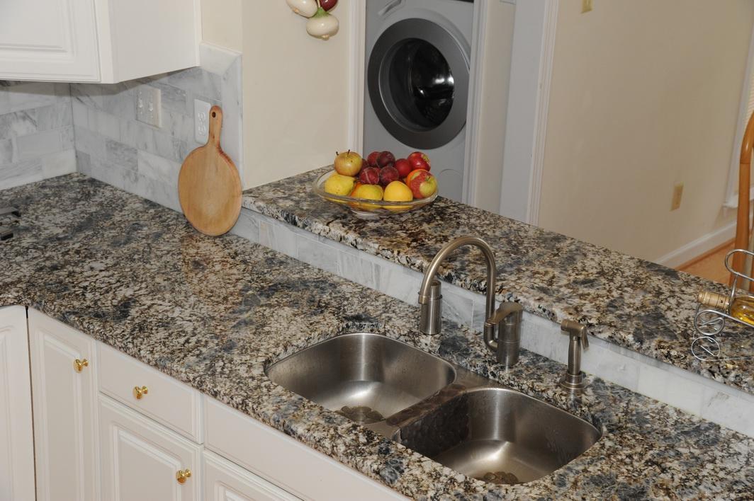 White Kitchen With Azul Aran Granite Countertops