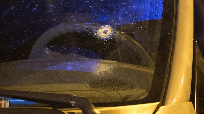 A bullet hole is seen in the windshield of a vehicle at the scene of a shooting in the first block of North Laramie Avenue on Oct. 8, 2016, in the South Austin neighborhood of Chicago.