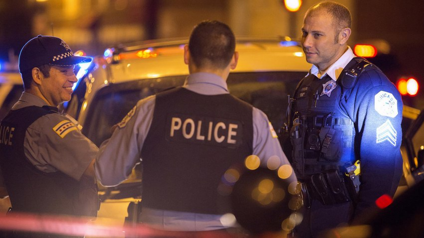 Members of the Chicago Police Department work at the scene of a shooting in the first block of North Laramie Avenue on Oct. 8, 2016, in the South Austin neighborhood of Chicago.