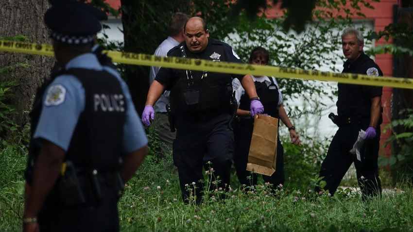 Police investigate the scene where a 16 year-old was shot and killed in a vacant lot on the 6700 block of Wabash Ave. in the Park Manor neighborhood on August 5, 2016.