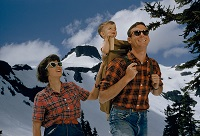 Happy hikers pass in front of Table Mountain in Washington by B. Anthony Stewart, April 1960
