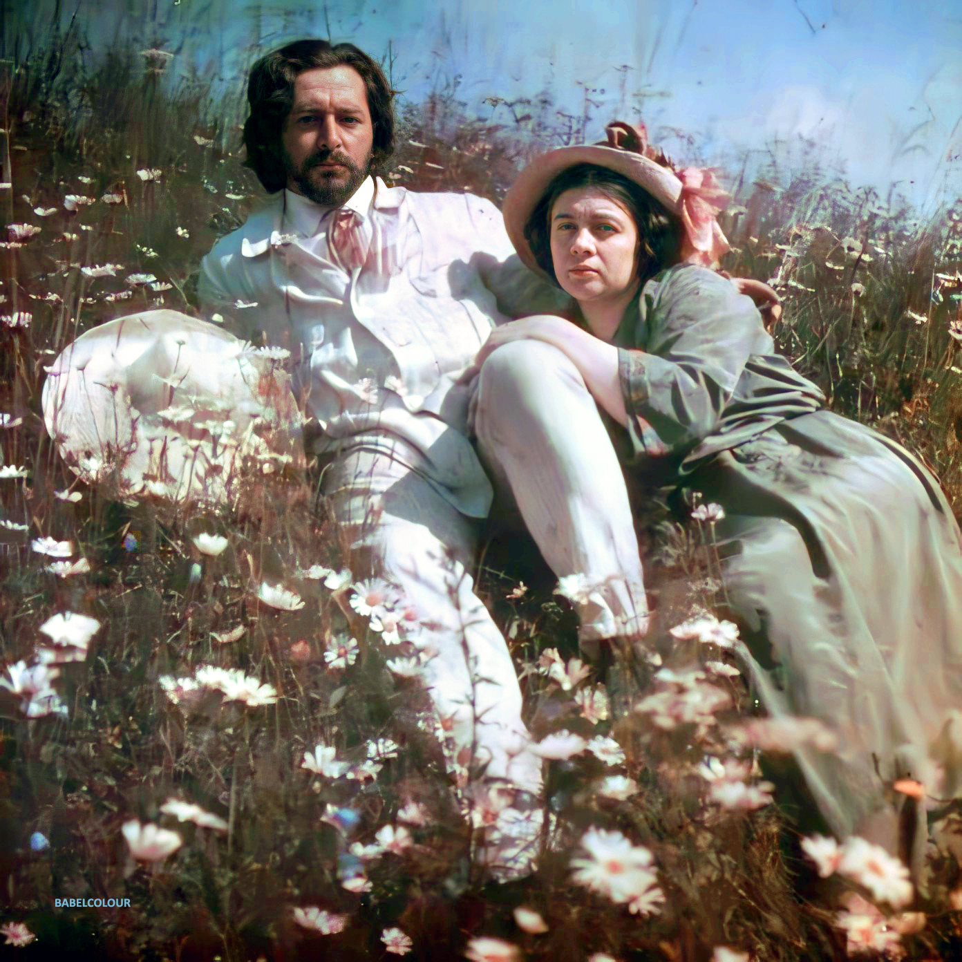 Leonid Andreyev (1871-1919) reclining amongst the bluebells & daisies with his second wife, Anna Denisevich, around 1910