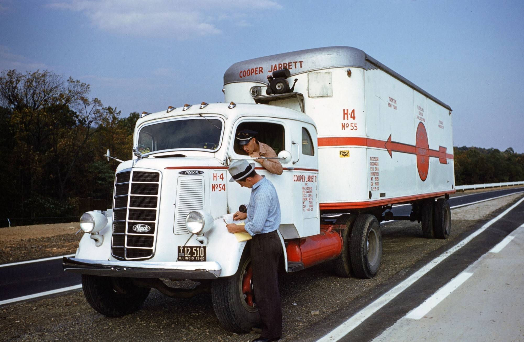 1940 A view of a truck driver, parking a Mack Truck alongside the interstate for Cooper Jarrett Motor Freight Lines in Illinois. (Photo by Ivan Dmitri