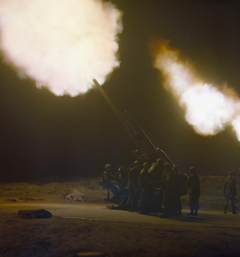 1940 England A battery of 3.7 inch anti-aircraft guns firing at night