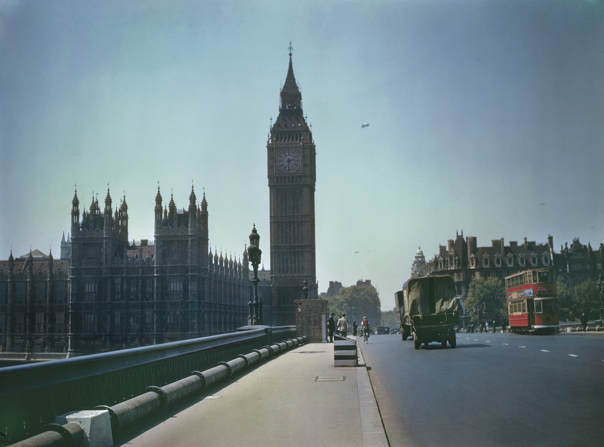 1940 Big Ben and the Houses of Parliament in London with barrage balloons in the background, seen from Westminster Bridge