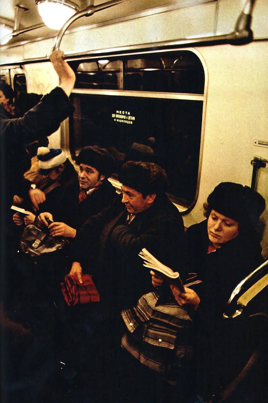 1978 Magazines and paperbacks occupy riders on Moscow's subway system by NG