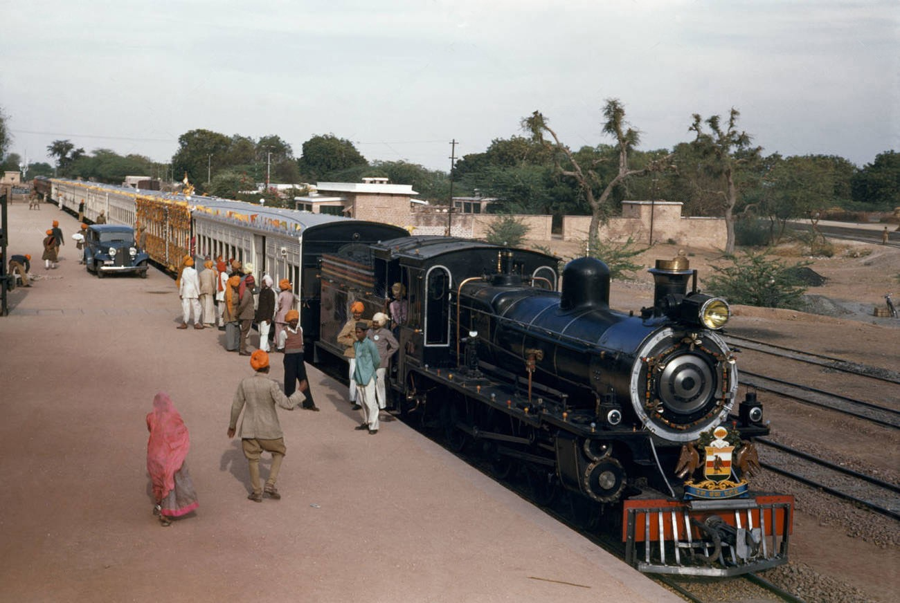 1948 India Jodhpur People stand on platform beside special train awaiting royal couple Volkmar