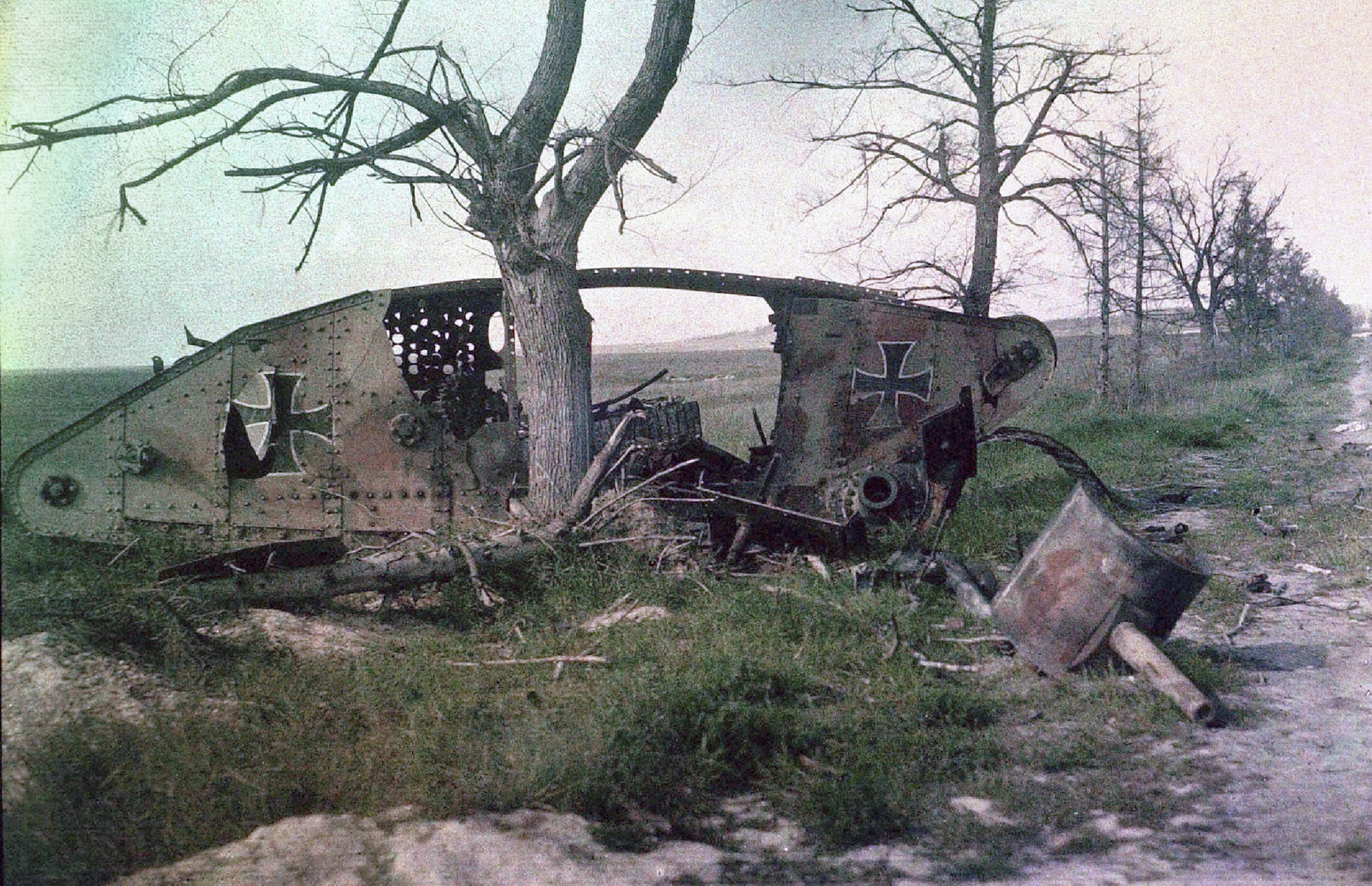 The wreckage of a British MarkIV or MarkV tank with German markings 1918
