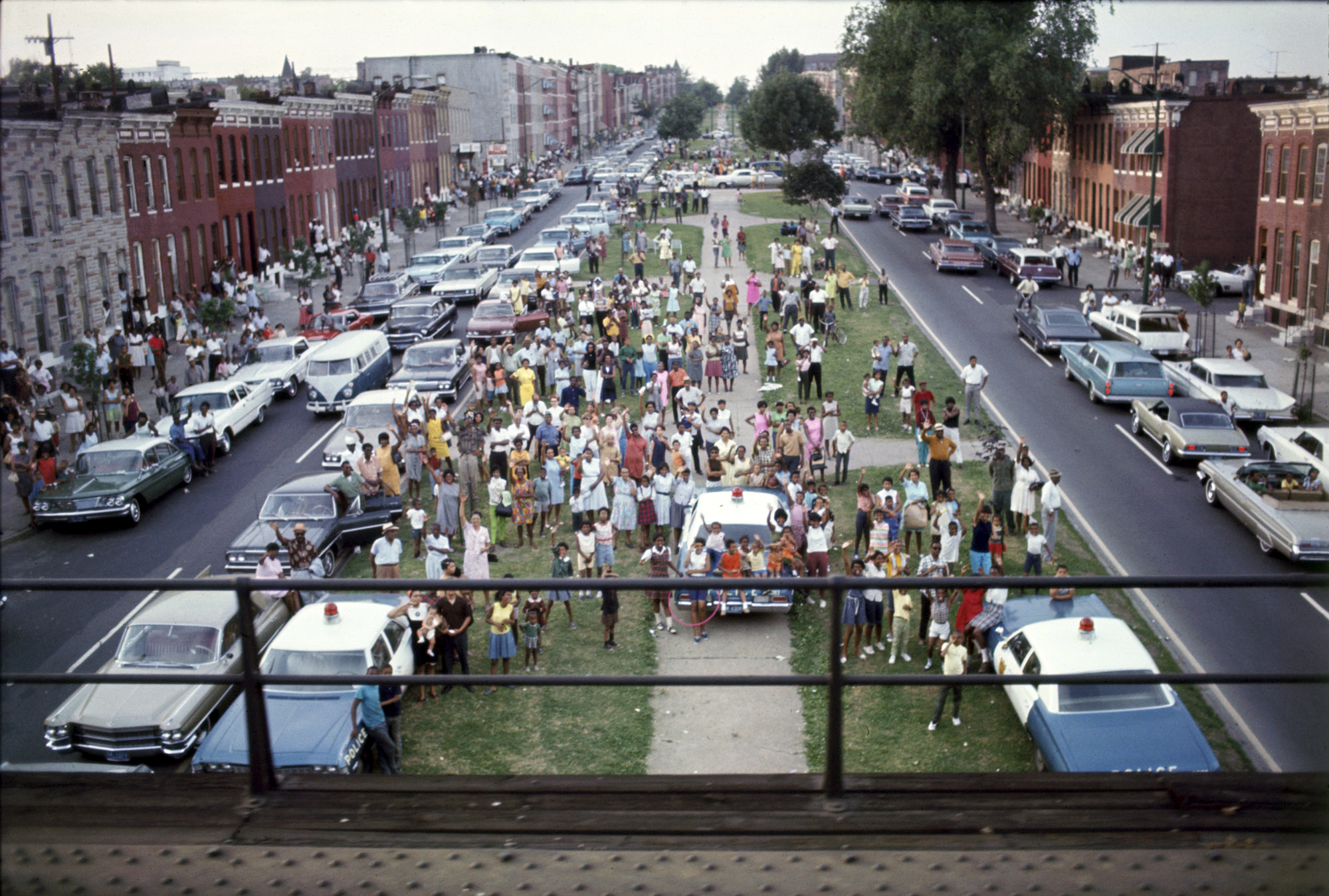 Watching the Robert F. Kennedy funeral train from Boradway, June 8,1968. Baltimore, Md. by Bill Eppridge
