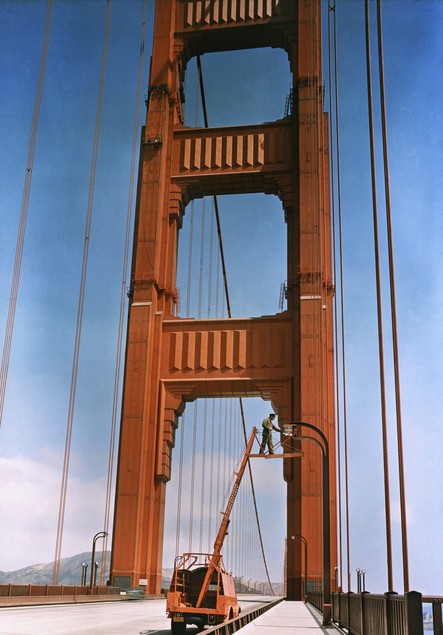 1938 A man repairs a light on the Golden Gate Bridge in San Francisco