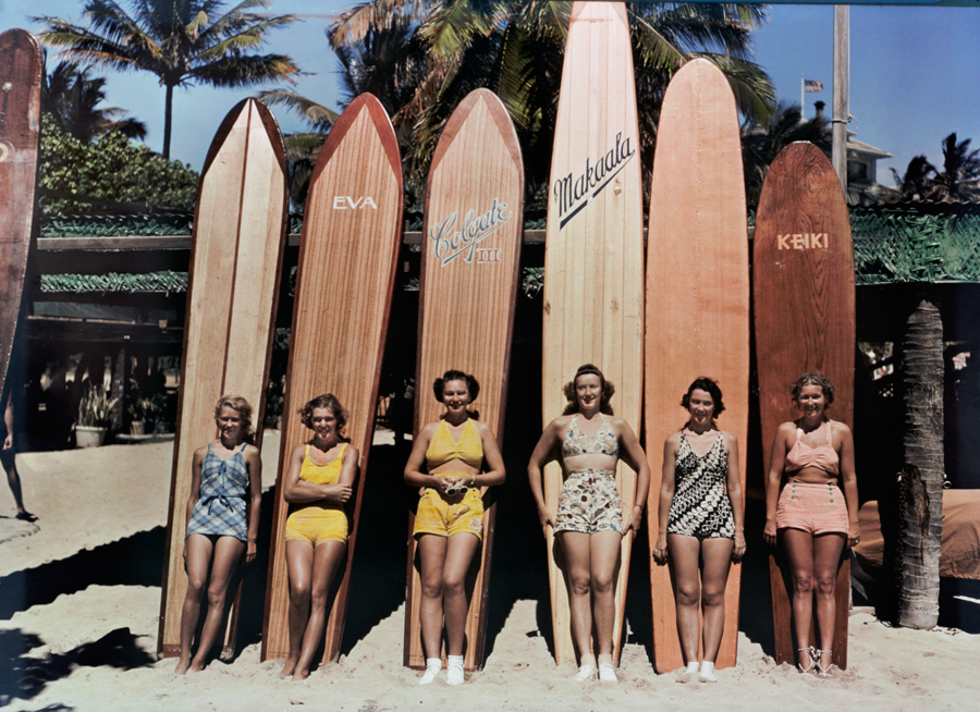 1938 November Women pose in front of their surfboards on Waikiki beach in Honolulu by Richard Hewitt Stewart