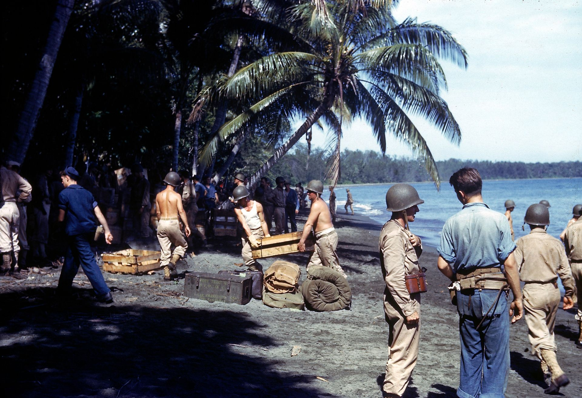American troops unloading supplies on the shores of Guadalcanal Island in 1943