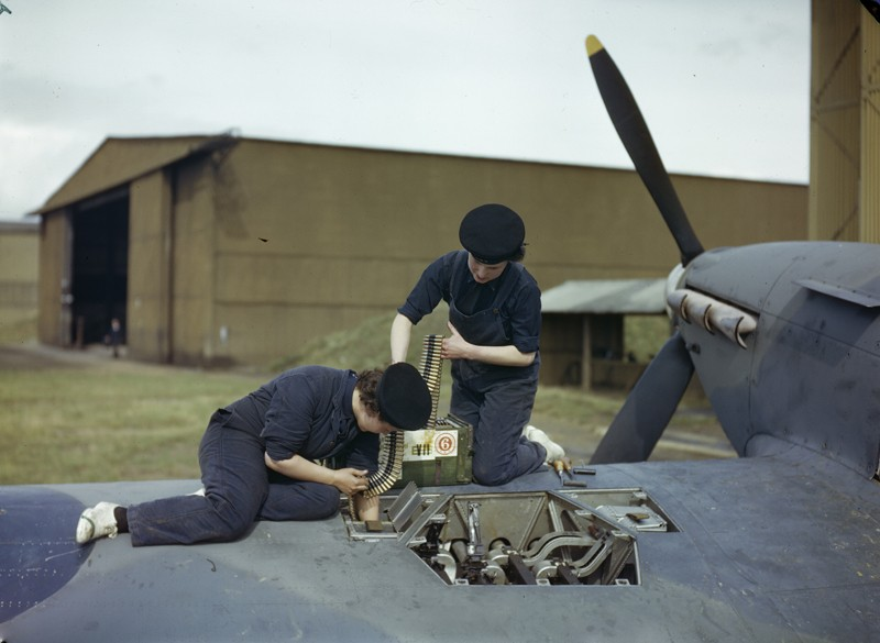 Armourers of the Women's Royal Naval Service (WRNS) re-arm a Hawker Hurricane aircraft at the Fleet Air Arm airfield at Yeovilton, Somerset, 2 September 1943