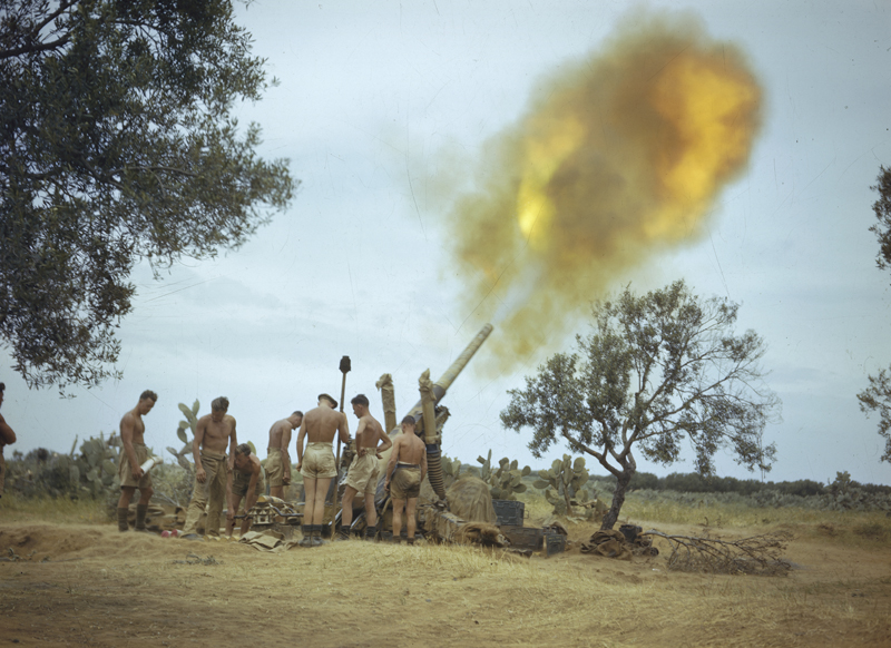 Soldiers of the Eighth Army in Tunisia fire a 4.5-inch gun four miles from the enemy lines, 1943