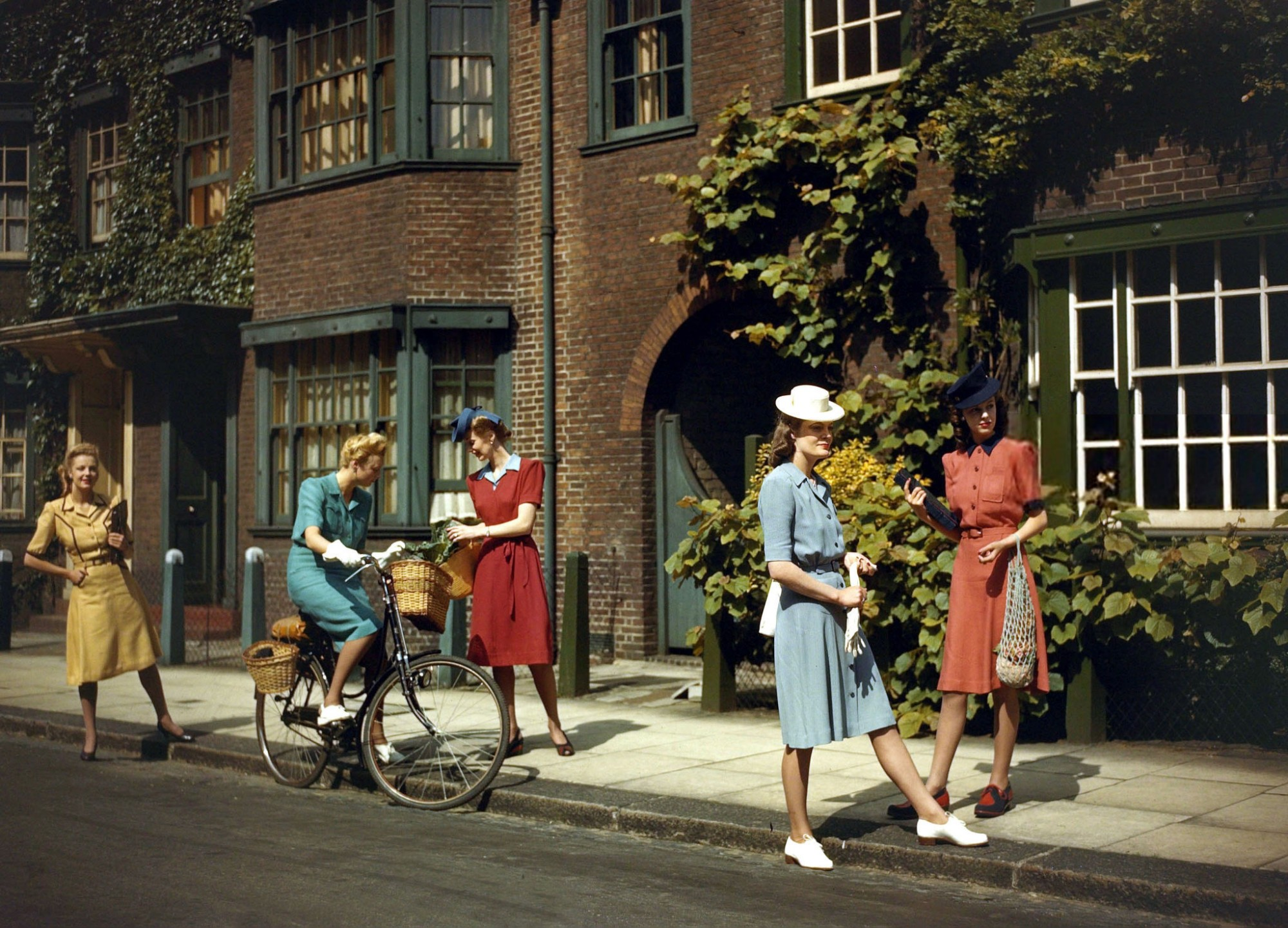 June 1943, Models wearing Berketex utility fashions designed by Norman Hartnell2
