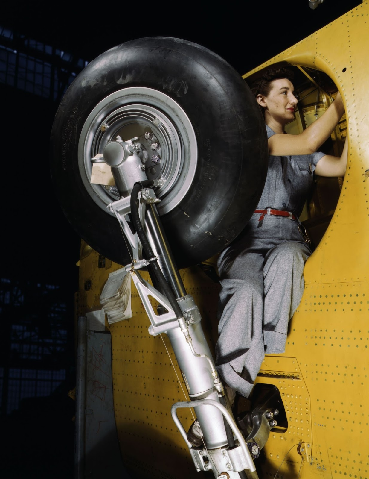 Alfred Palmer - Woman Working on a Bomber's Wheel Well, 1943