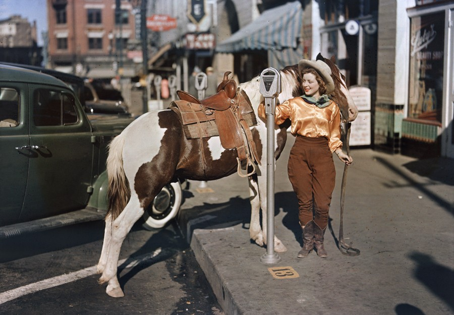 1939 A cowgirl puts a nickel in an El Paso parking meter to hitch her pony by Luis Marden