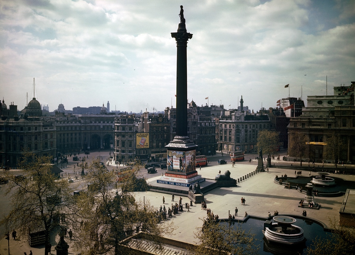 1944c London Trafalgar Square in London showing 'Carry on London' and 'Salute the Soldier' propaganda hoardings on Nelson's Column2