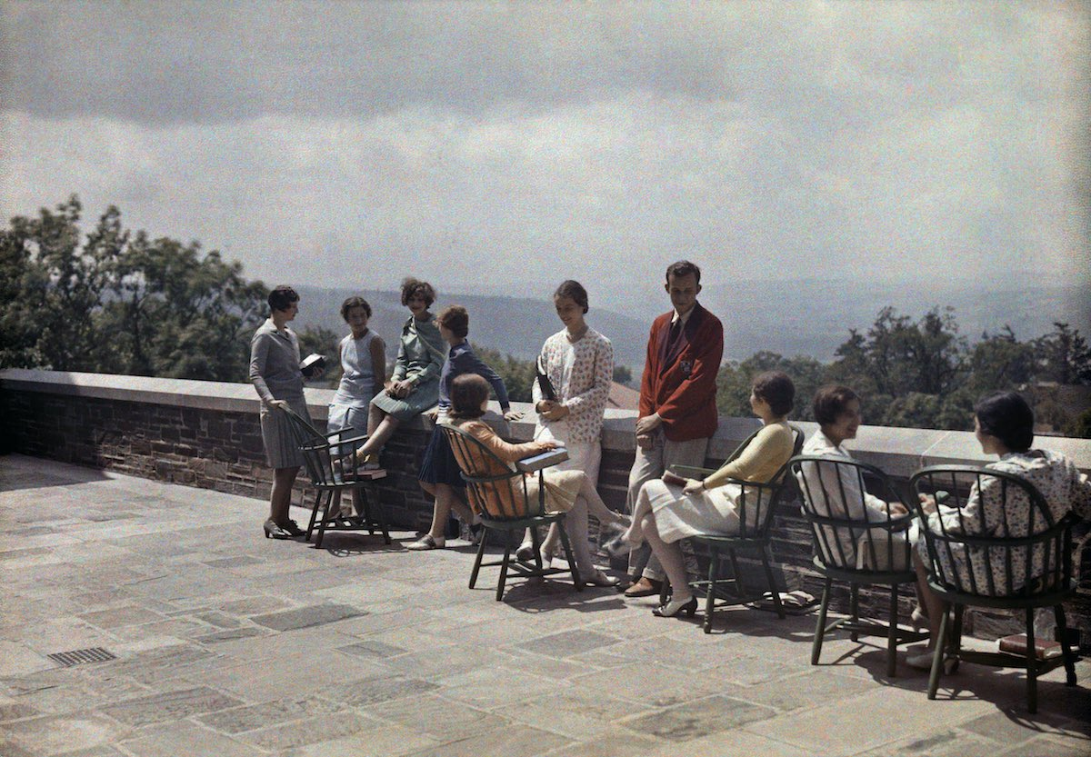 1929 New York State - A group of students relaxes on the terrace at Cornell University. by C. Adams