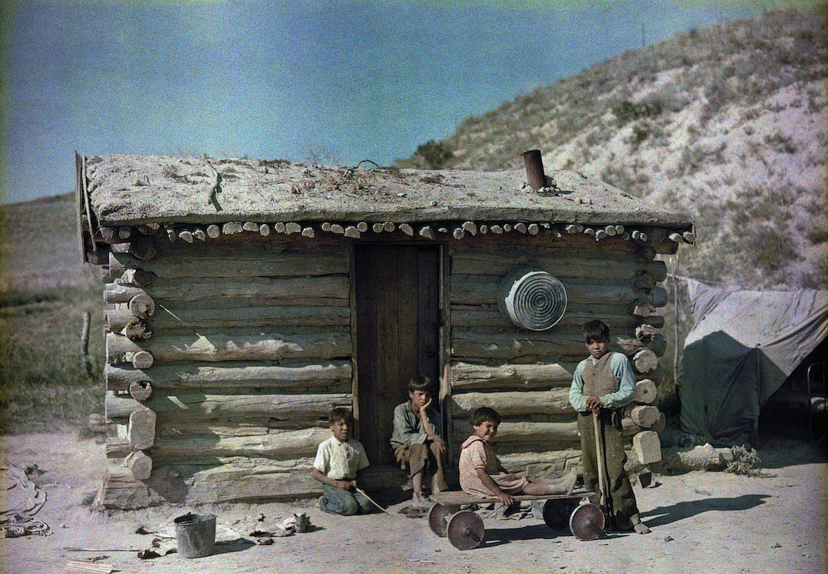 1929 Pine Ridge Indian Reservation, South Dakota – Boys pose outside a sod roof house. Richard Hewitt Stewar
