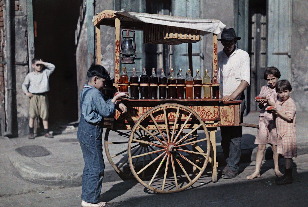 1929c New Orleans, Louisiana - Children gather by a vendor selling snowball treats
