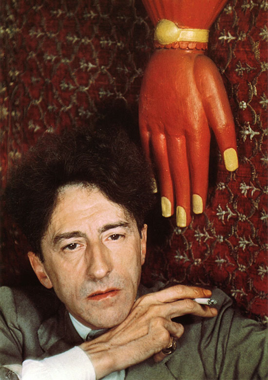 Jean_Cocteau_with_red_hand_Paris_1939