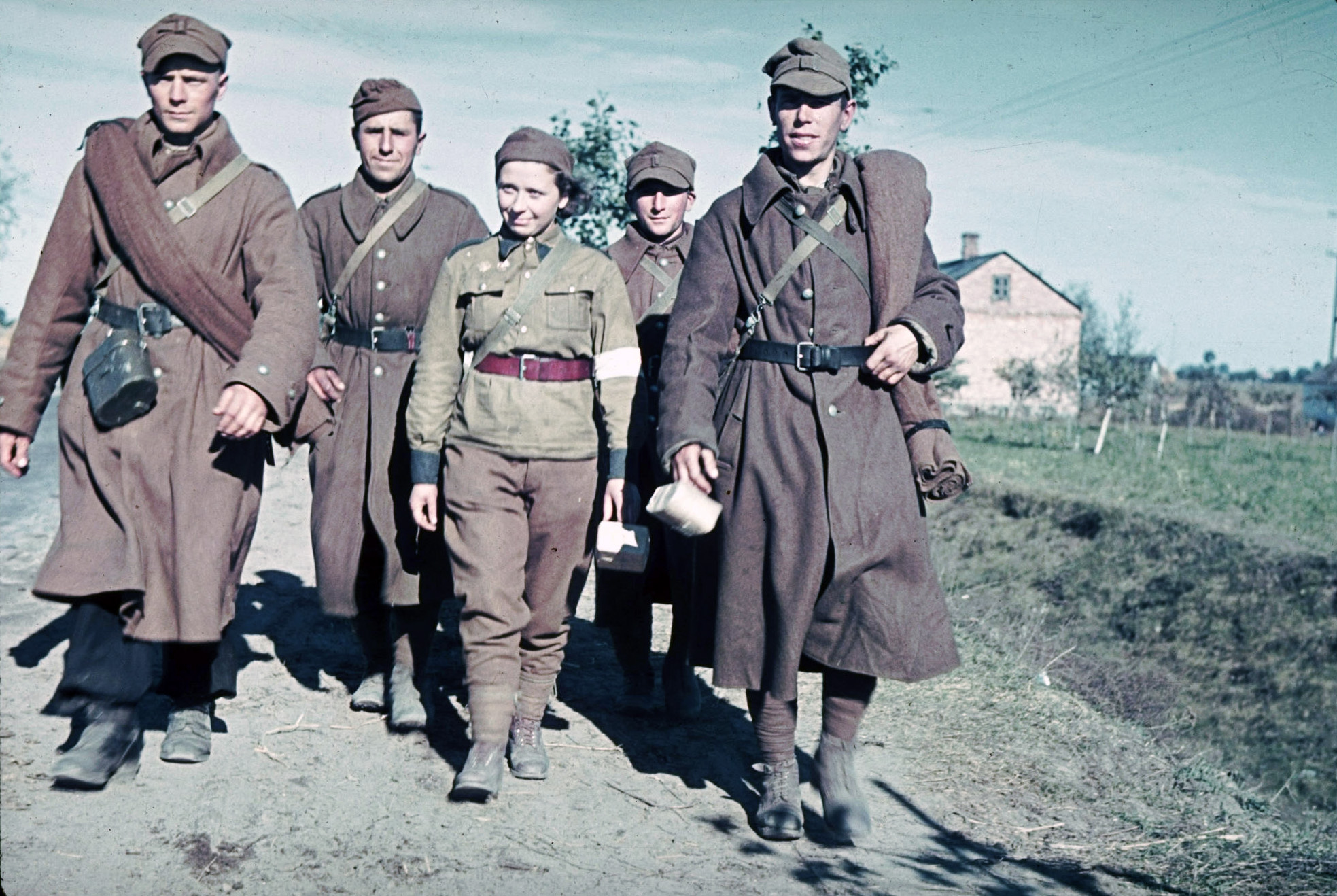 Polish soldiers and a Red Cross nurse (C) captured by the Germans during the Polish invasion by Germany  by Hugo Jaeger