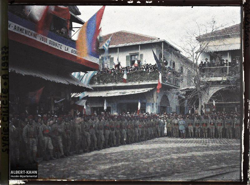 December 10, 1919 French Senegalese soldiers standing to attention under an Armenian flag, in Cilicia, Turkey