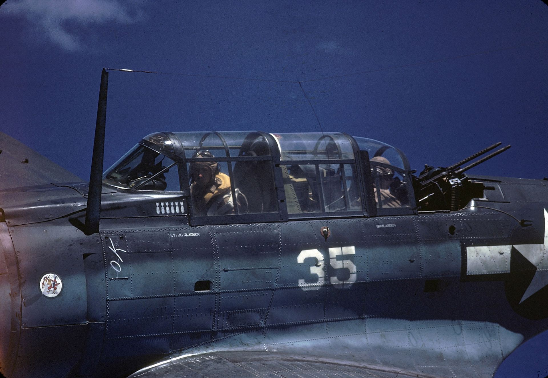 A Douglas SBD piloted by American Lt. George Glacken (left) with his gunner Leo Boulanger, near New Guinea, early April, 1944