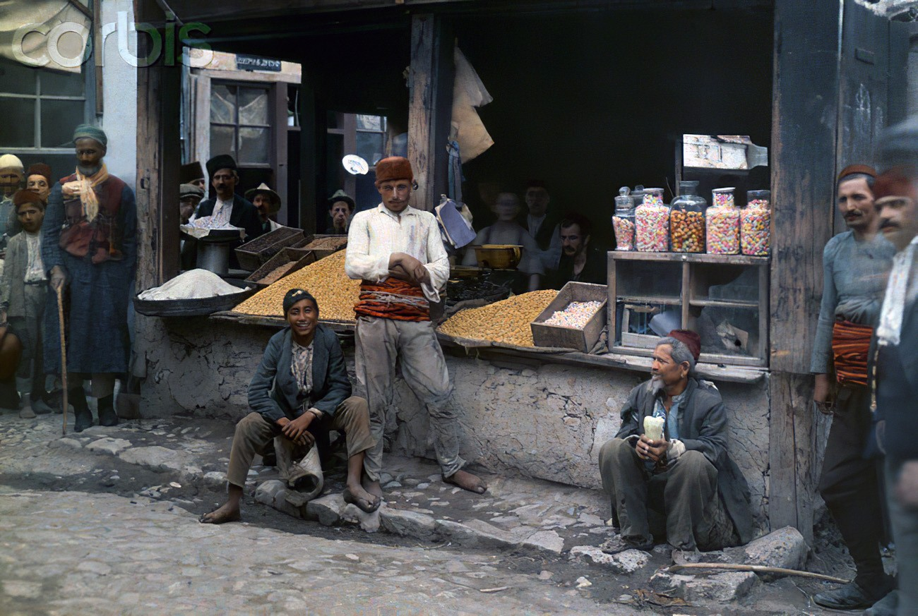 1930 Islamic men at an open air food store in Skopje by HH_cmpk
