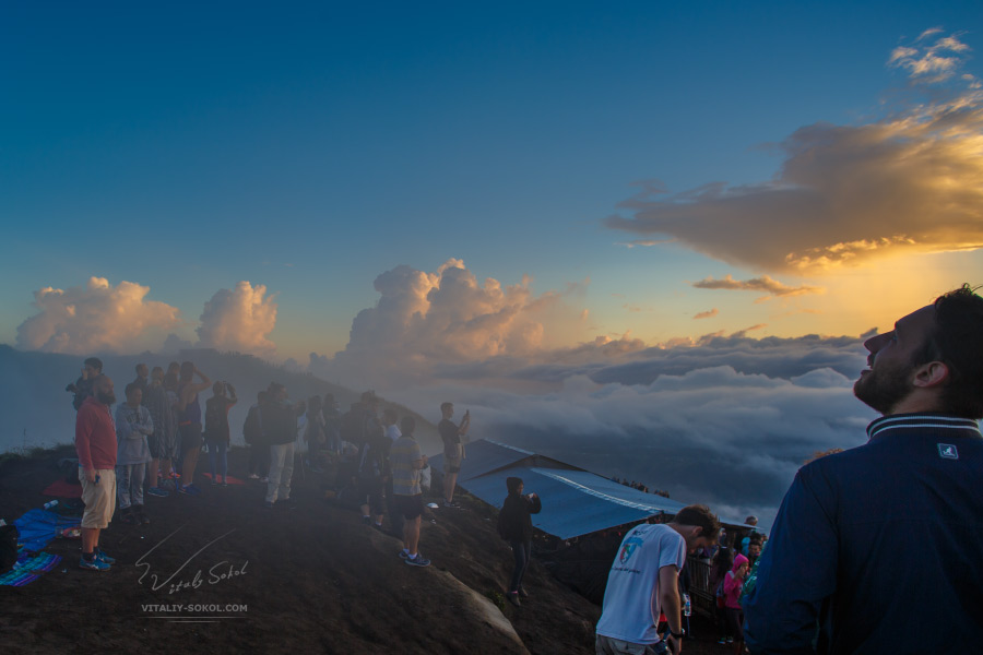 Sunrise at Batur Volcano and people at the hike