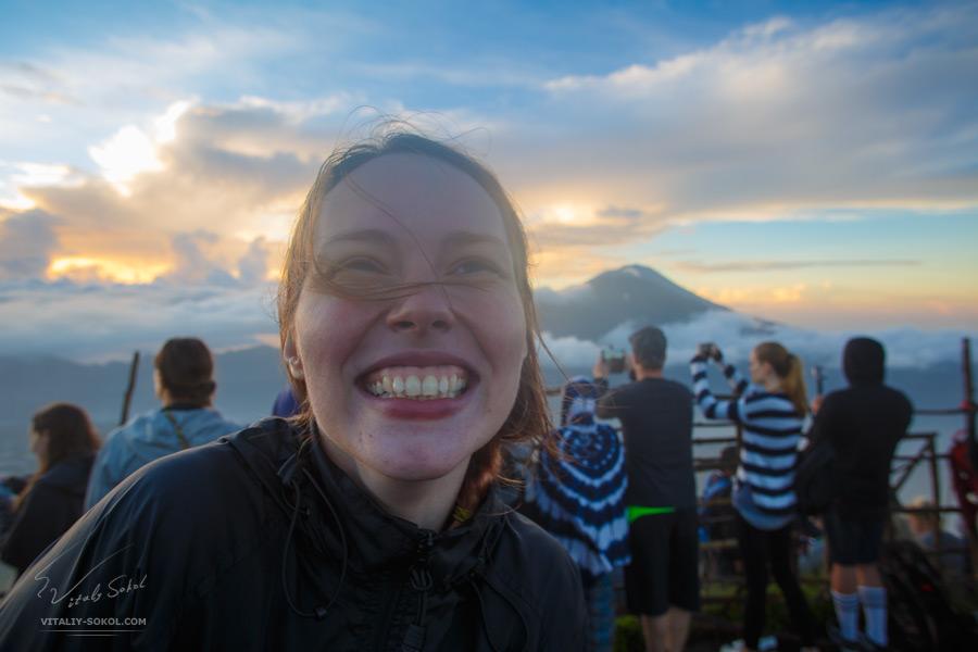 Smiling happy Miara in the light of Batur sunrise