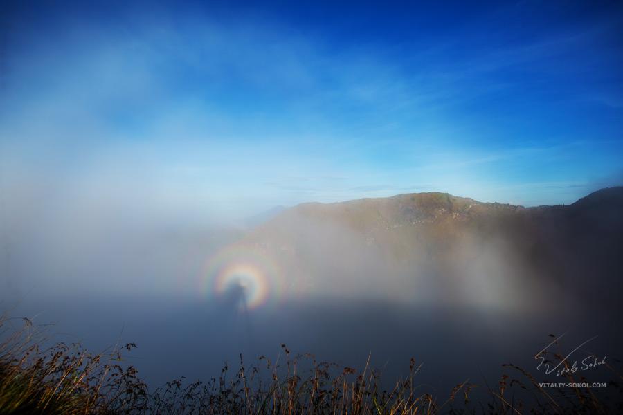 Batur volcano with rainbow