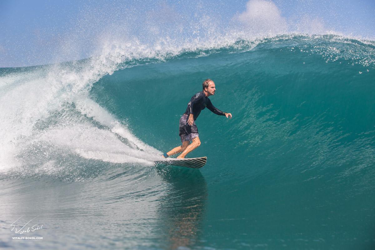 Surfer Riding a big blue ocean wave