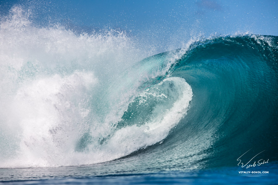 Surfing in Bali. Big blue powerful ocean wave