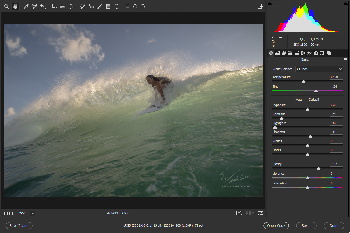 A surfer girl starting from shining ocean wave. Camera RAW settings