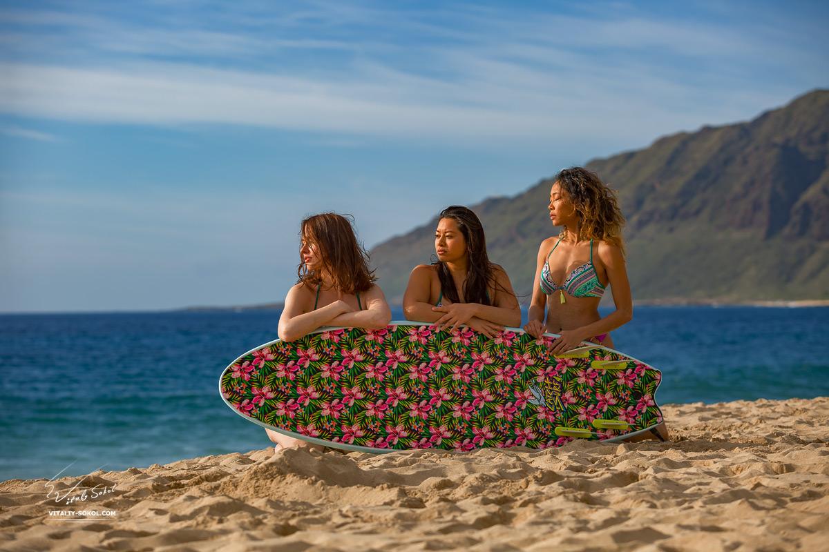 Surfer girls at sandy beach