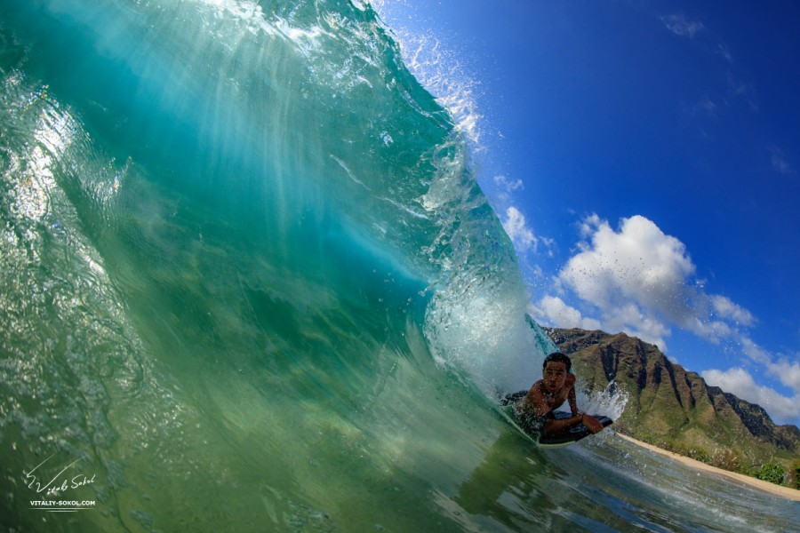 A Boy getting barrel in Hawaiian surfing wave